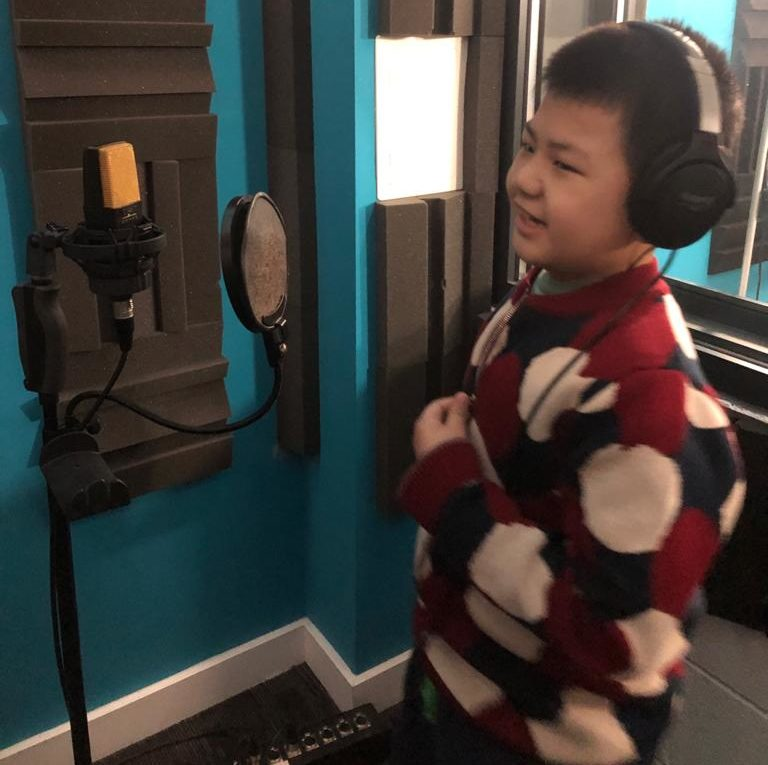 Boy in a soundbooth